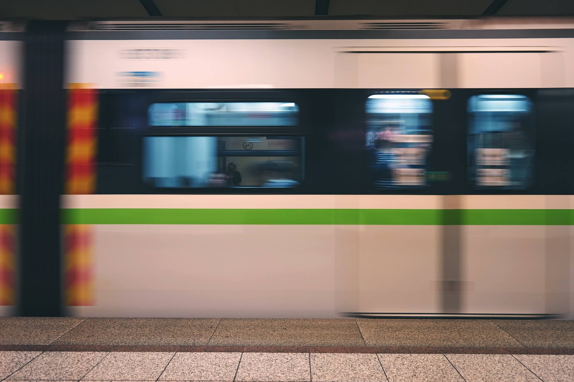 Metro train speeding up in the subway